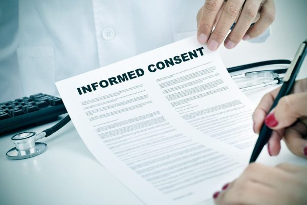 signing an informed consent form.