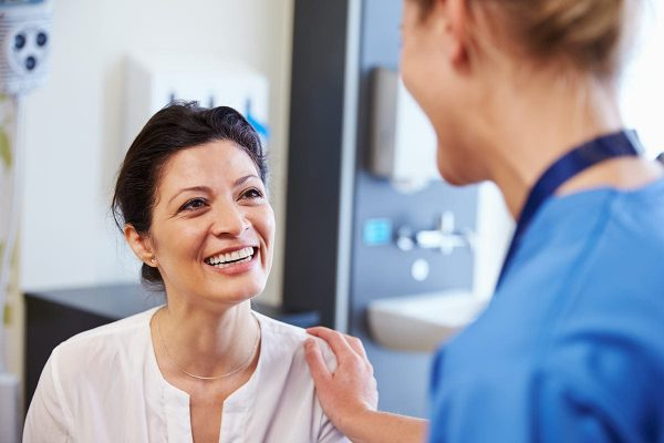 woman talking with nurse ato Rocky Mountain Clinical Research.
